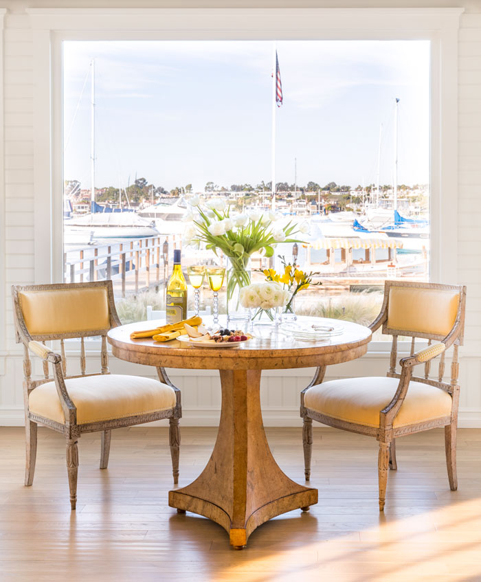 This picture window provides a stunning view to the marina just outside.