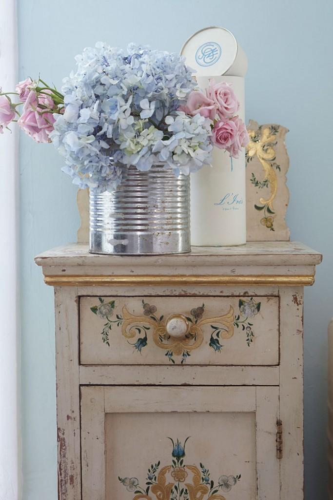 Hand-painted details add character and charm.