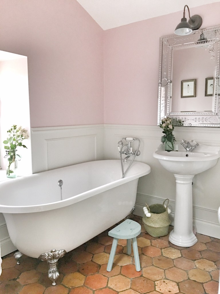 A pink bathroom in the French country home of Charlotte Reiss of Vivi et Margot