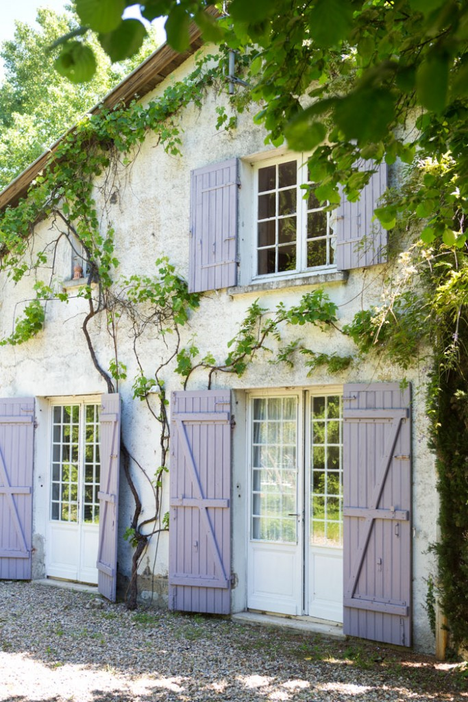 The color enhances both the natural surroundings and the home's French fairy tale aesthetic.