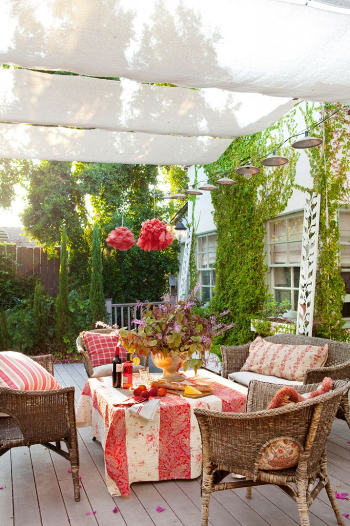 For a special evening, bring some décor outside and create a cozy space for you and a loved one. Though this patio isn't in Paris, with comfy seating, wine and appetizers, it is just as romantic.