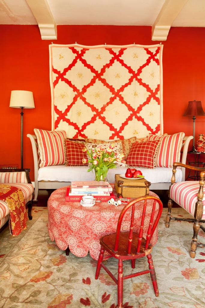 Vibrant reds, soft yellows and creams make this living room both exciting and relaxed.