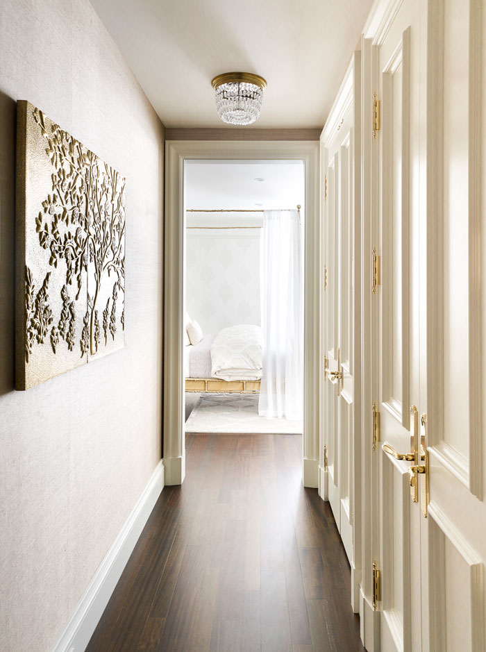 This open hallway's light color scheme gives way to the natural light beaming in from the windows.