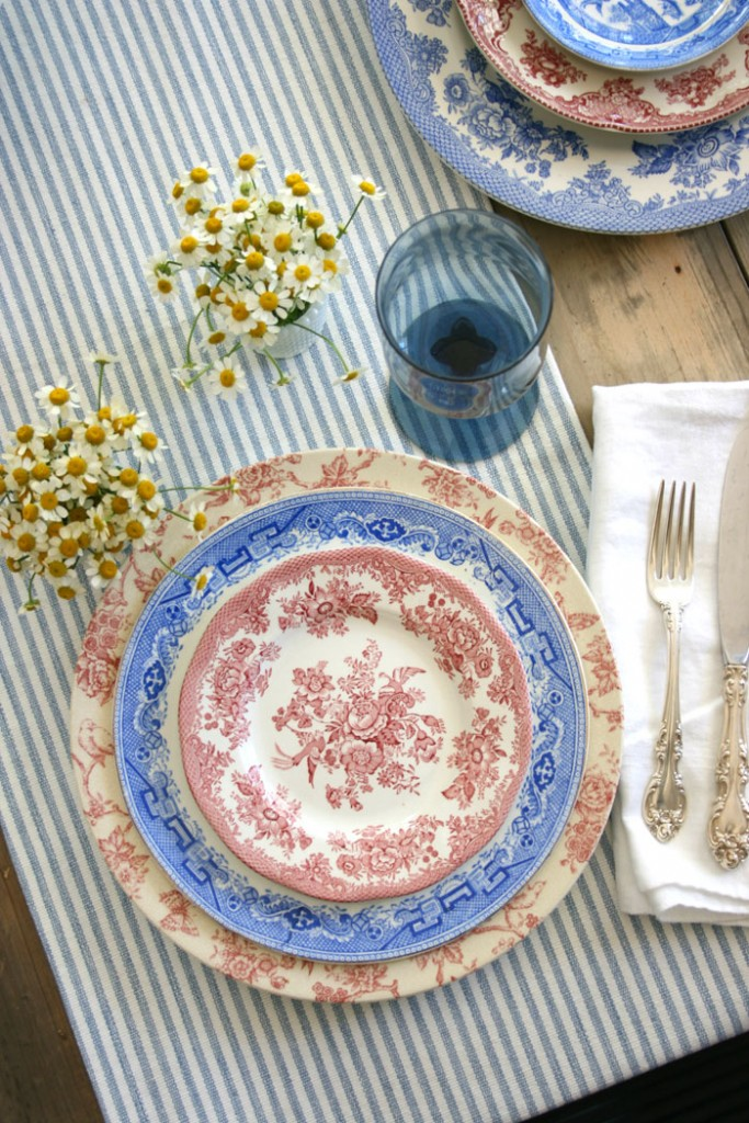 A ticking stripe runner sets the groundwork for the rest of the table, and softens the look of the rustic farmhouse table.
