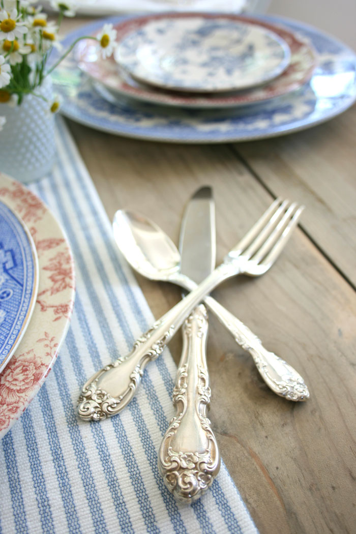 Grandmother's treasured silver adds a touch of glitz and nostalgia to the table.