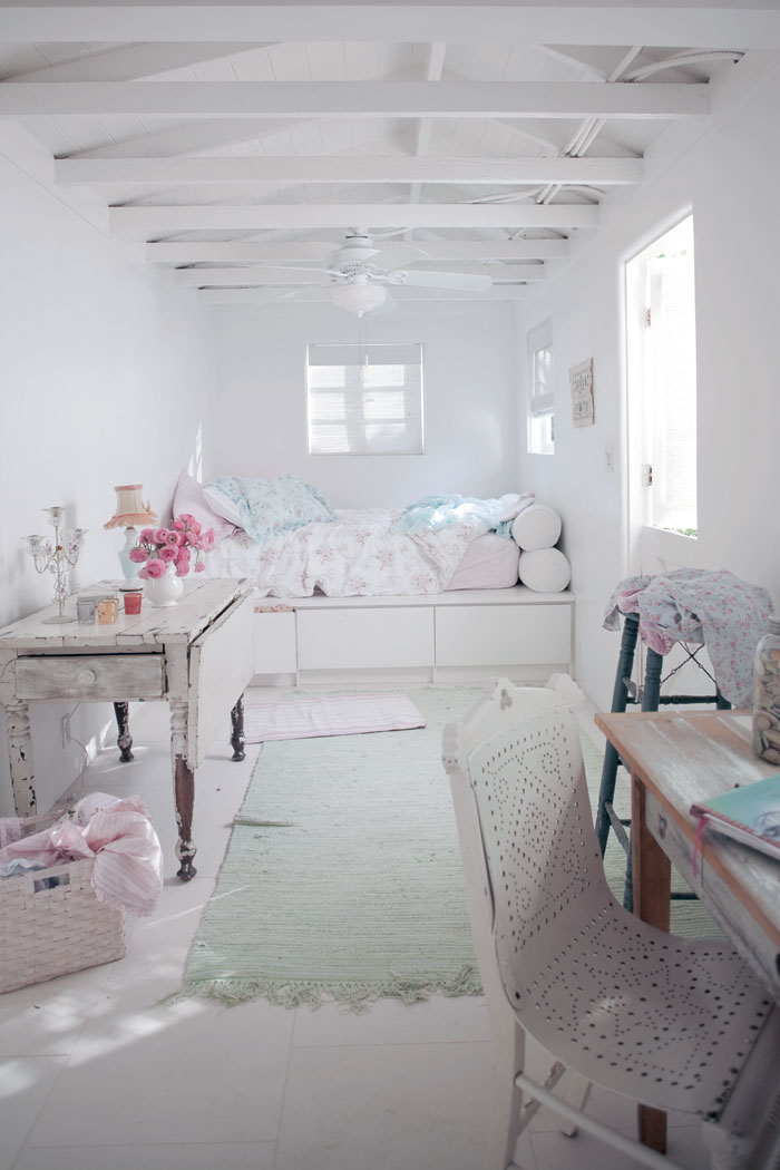 Natural light filters through the open dutch door, filling the cozy but bright space with sunshine and the ocean air at Rachel Ashwell's Shabby Chic beach house.