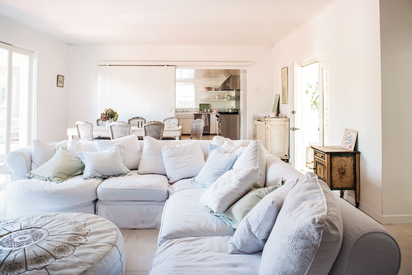 Dreamy details: My living room resembled a big fluffy cloud with my Shabby Chic Bloomsbury white slipcovered sectional, big and comfy for family gatherings and unexpected sleepovers.