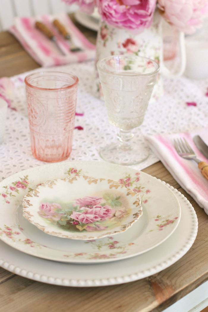 Collect and display rose china patterned plates with hints of pink as a common motif for your vintage tablescape.