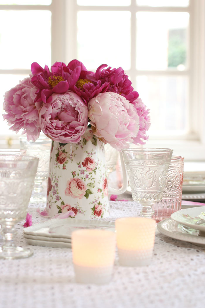 Set peonies at the center of the table as you collect and display rose china patterned servingware.