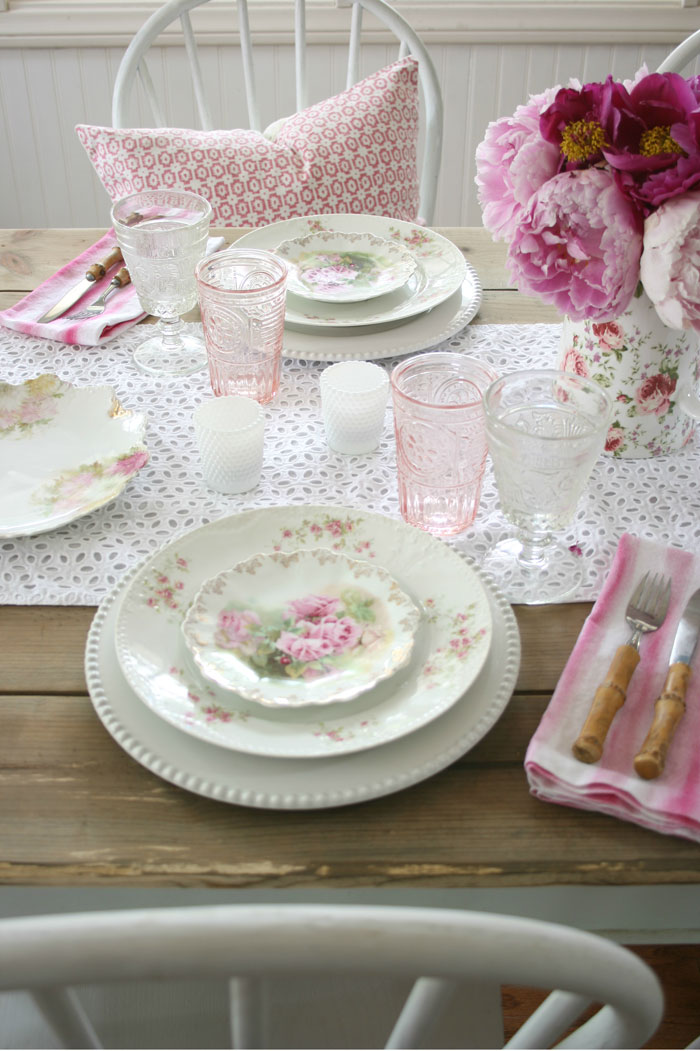 Feminine details set against the farmhouse table and chairs will create the perfect romantic table setting as you collect and display rose patterned china