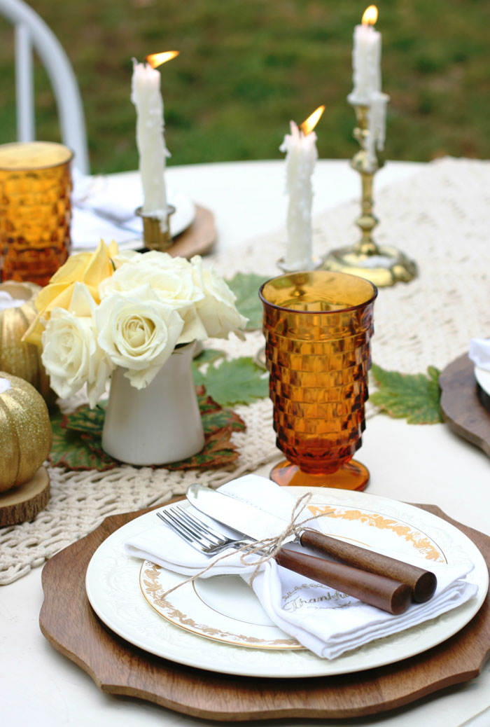 The colors of Autumn are nicely balanced at this elegant Thanksgiving table setting