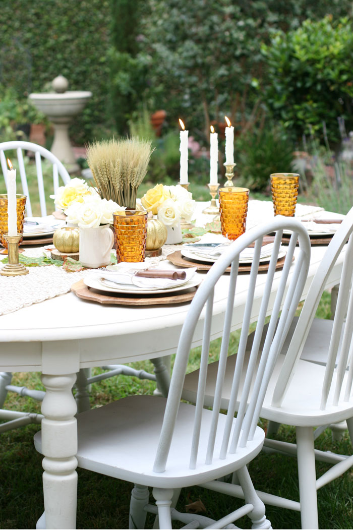 The amber of these vintage glasses brightens the table of this Thanksgiving table setting