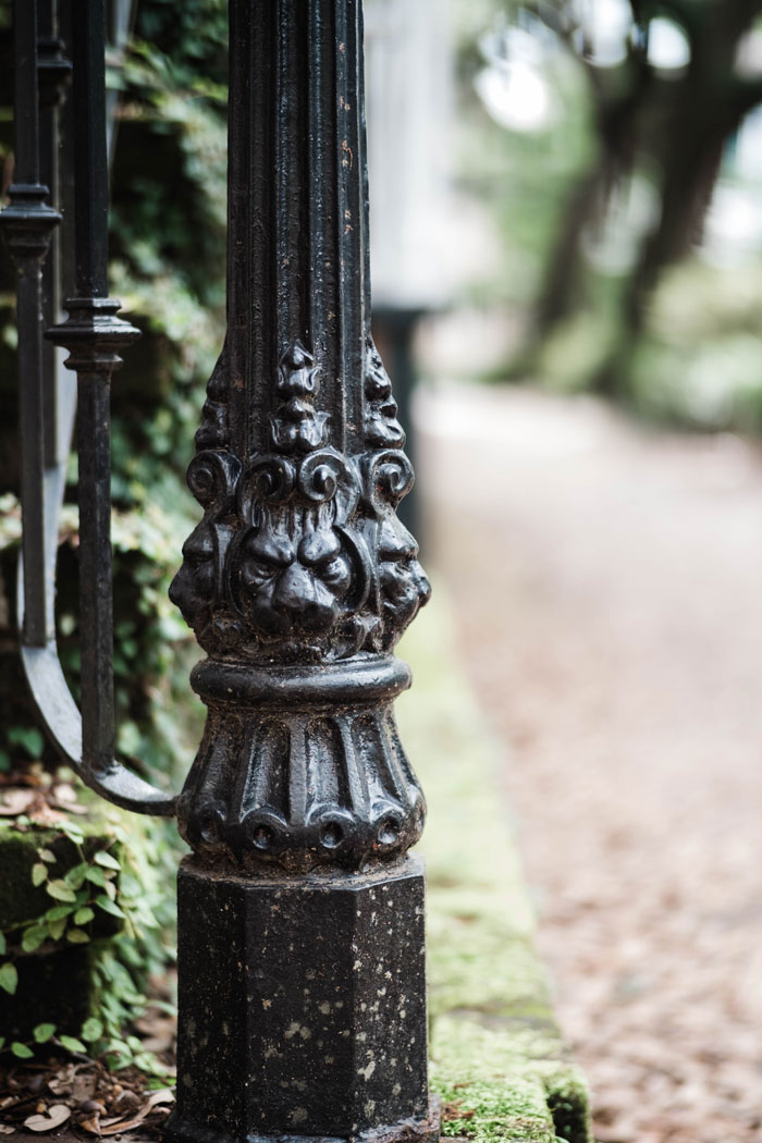 Architectural Details-A lamp post is guarded by lion heads in all directions. Photo by Kayla DeVito.