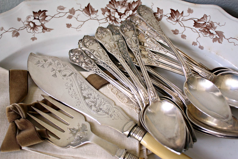 Intricately detailed patterns make collecting antique silverware a captivating hobby.
