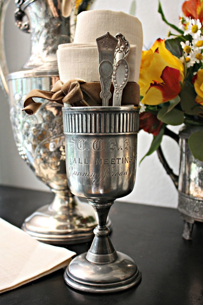 A vintage inspired tablescape set with antique silver servingware.