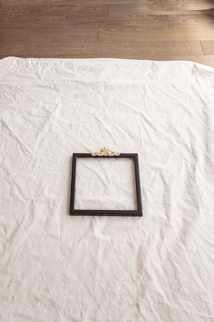 Adding a wooden appliqué gives the frame an extra flair. - Vintage French Decor by Jaimie Lundstrom