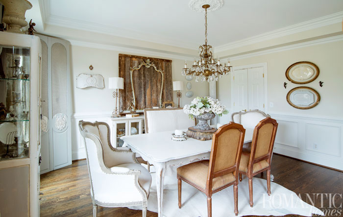 The chandelier's French provincial style nicely compliments the home's vintage decor