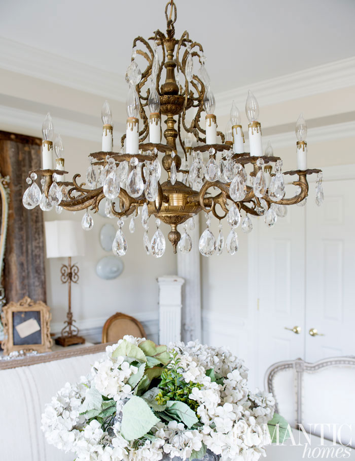 The vintage decor of the home is complimented by a gold and crystal chandelier in nearly every room