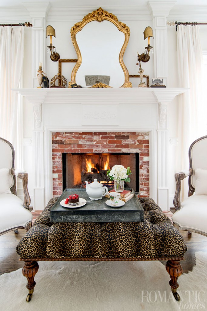 Historic bricks were reassembled to adorn the home's fireplace, which is juxtaposed with the footstool's audacious leopard print pattern.