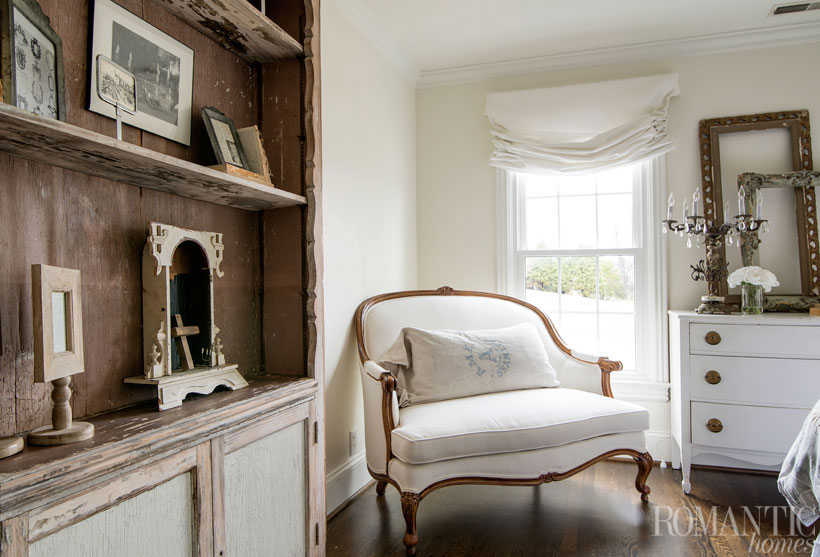 A chair in the French provincial style completes the vintage decor of the bedroom