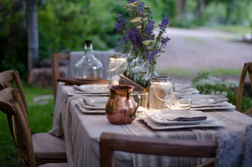A copper pitcher adds warmth to the outdoor table setting