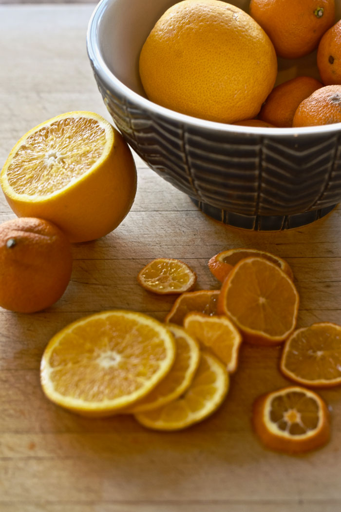 Give your DIY Christmas wreath visual interest by cutting your citrus into a variety of sizes.