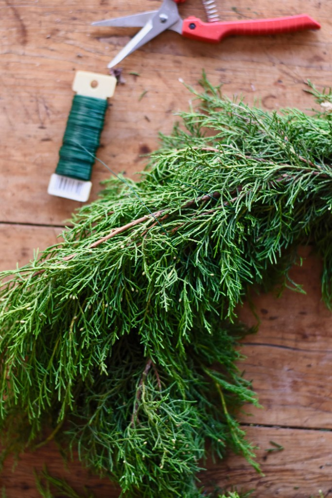Attach your evergreens together using floral wire for stability.