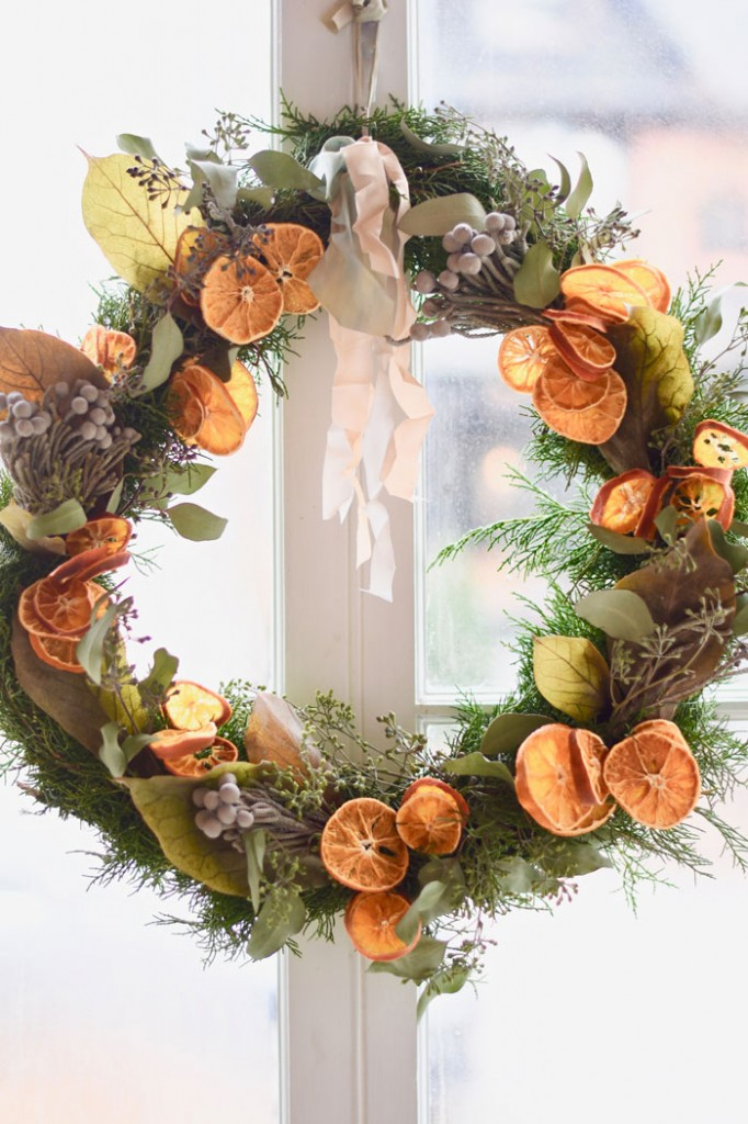 Use the same process to make little bundles with the dried florals – or simply poke the dried florals into the wire that is holding the wreath together.