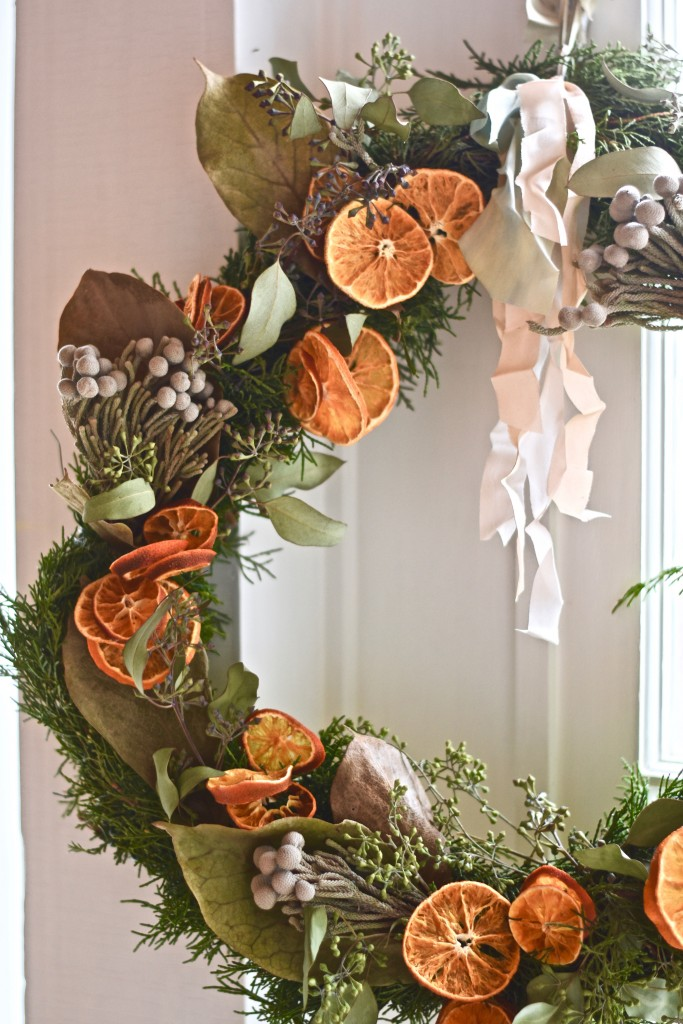 A fresh orange in a Christmas stocking is an age-old holiday tradition that this wreath references with it's own updated twist. #romantichomes
