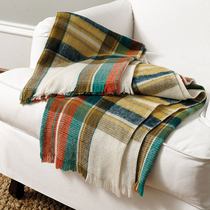 Farmhouse harvest style requires some plaid and this cozy throw is the perfect addition! Create Cozy Feelings with Fall Farmhouse Decor #romantichomes