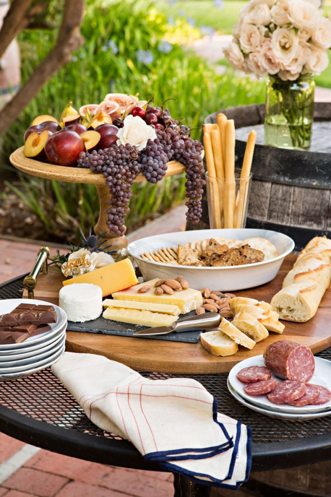 Keep small plates and multiple cheese knives available for guests to easily serve themselves from the handcrafted cheese board. #romantichomes