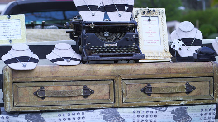 Ruth uses a worn, vintage suitcase as a platform to display her antique Underwood typewriter.