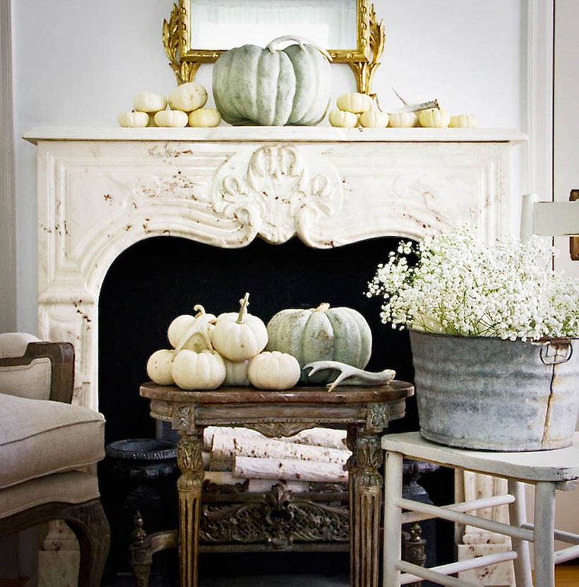 White baby pumpkins, birch branches and a zinc bucket of baby's breath all contribute to the elegant fall look of this fireplace. #romantichomes