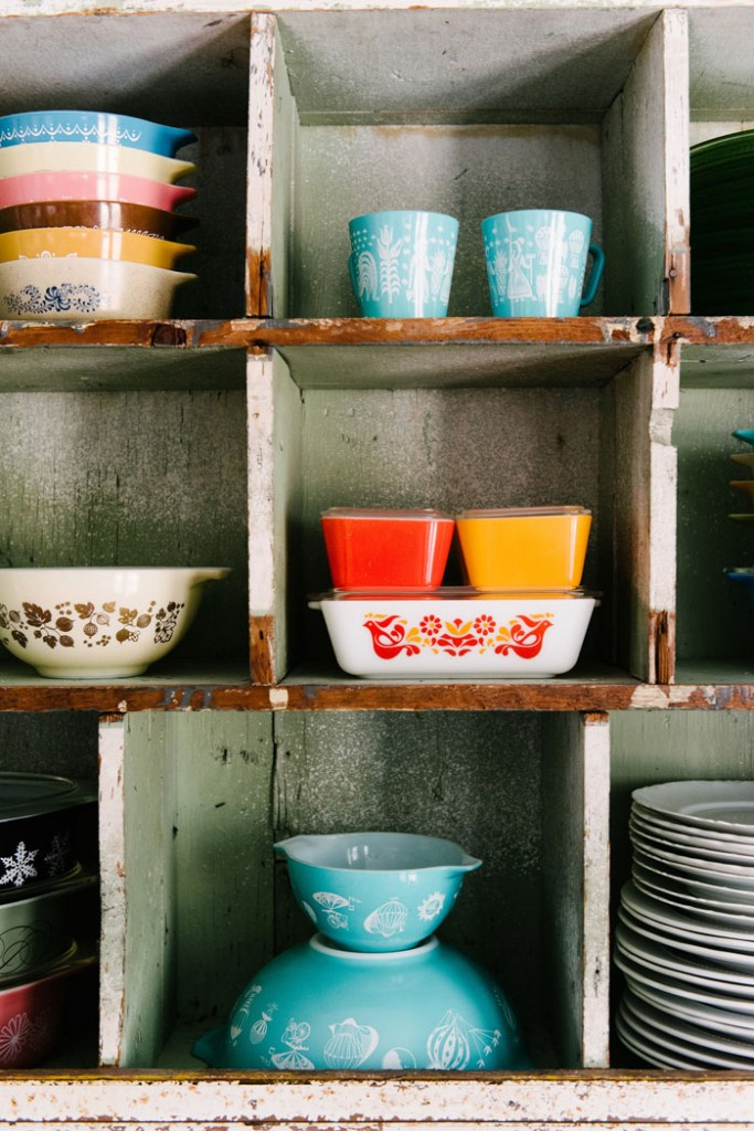 Top, center: Turquoise Butterprint mugs. Middle, center: Refrigerator storage dishes in red and yellow, with the Friendship pattern below. Bottom, center:  Hot Air Balloons pattern Cinderella bowls.  #romantichomes