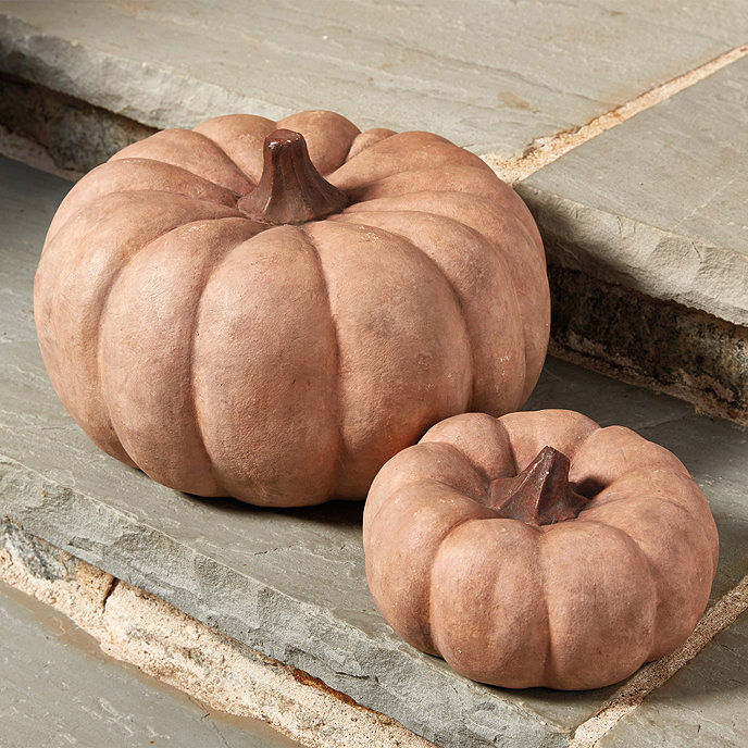 Nothing says harvest farmhouse like fall pumpkins and these terra cotta specimens will last forever. Create Cozy Feelings with Fall Farmhouse Decor #romantichomes