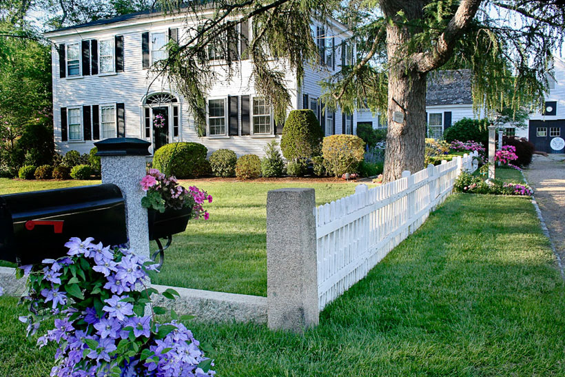 For the exterior of their dream home, the couple simply painted the front door black and changed the landscaping to fit their taste.