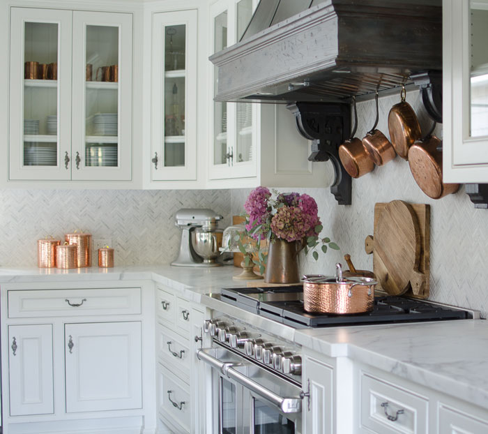 The deep hues of pink and purple hydrangeas pop against Karen's white and gray kitchen, where copper adds a warm metallic touch. Perfect for the autumn season.