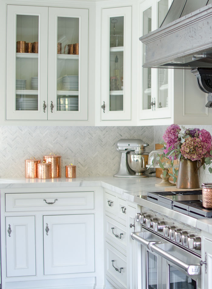 Use the changing seasons and changing decor as an opportunity to experiment on a low-risk level with mixed metallics. Karen already has silver-toned fixtures in her kitchen, and they blend perfectly with the seasonal addition of copper metallic touches.