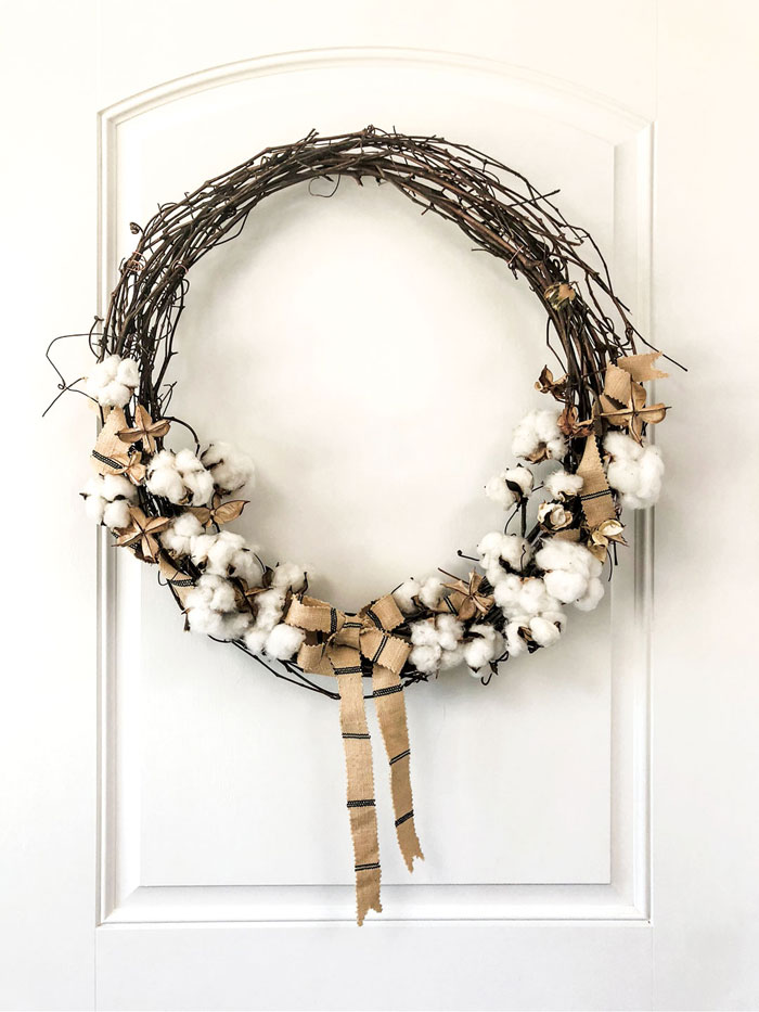 The brown star shapes are the same pods but without the fluffy cotton. Intersperse these throughout the DIY wreath for variety.