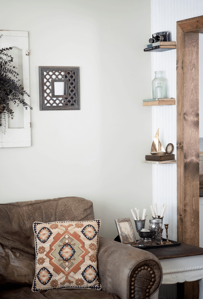 Living room corner with vintage books and vignettes