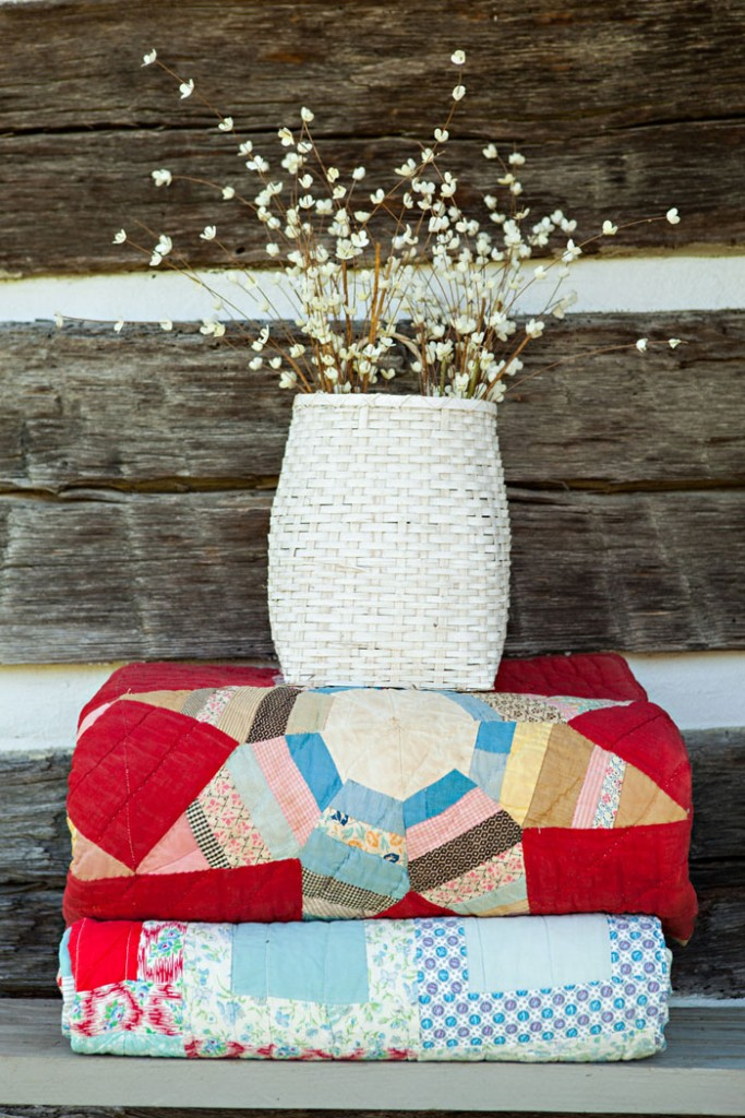 A stack of two vintage quilts. -How to Collect and Care for Quilts