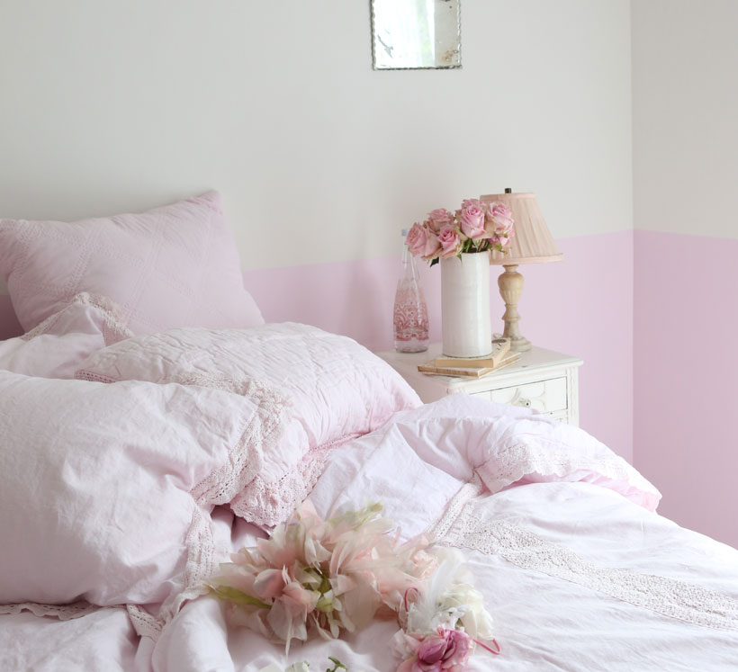 Rachel Ashwell paints the bottom portion of bedroom walls pink to add color and anchor the space.