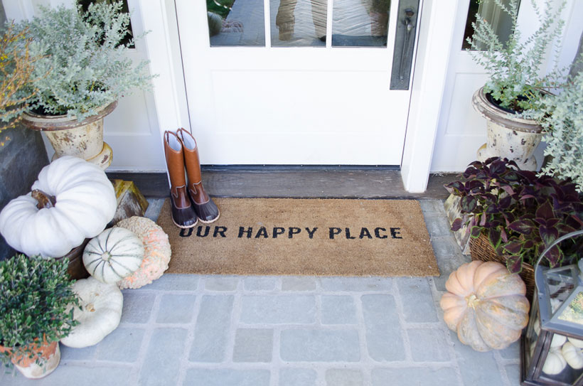 "Karen Snyder's doormat reads ""Our Happy Place"""