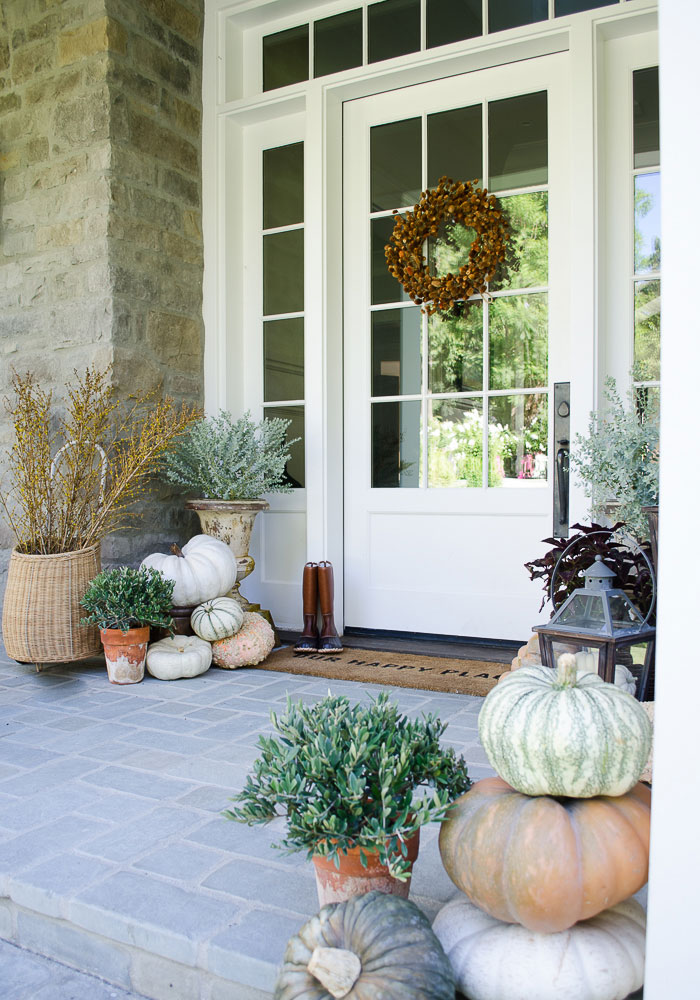 Heirloom pumpkins on the front porch make a welcoming first impression