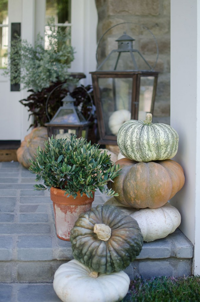 Karen Snyder's front porch is decorated with a stack of heirloom pumpkins - Romantic Homes