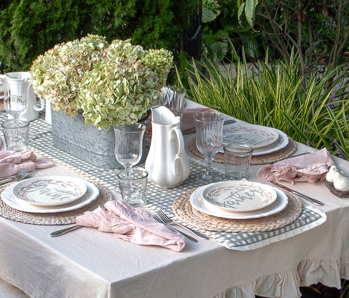 Ironstone pitchers add farmhouse appeal to this romantic fall tablescape