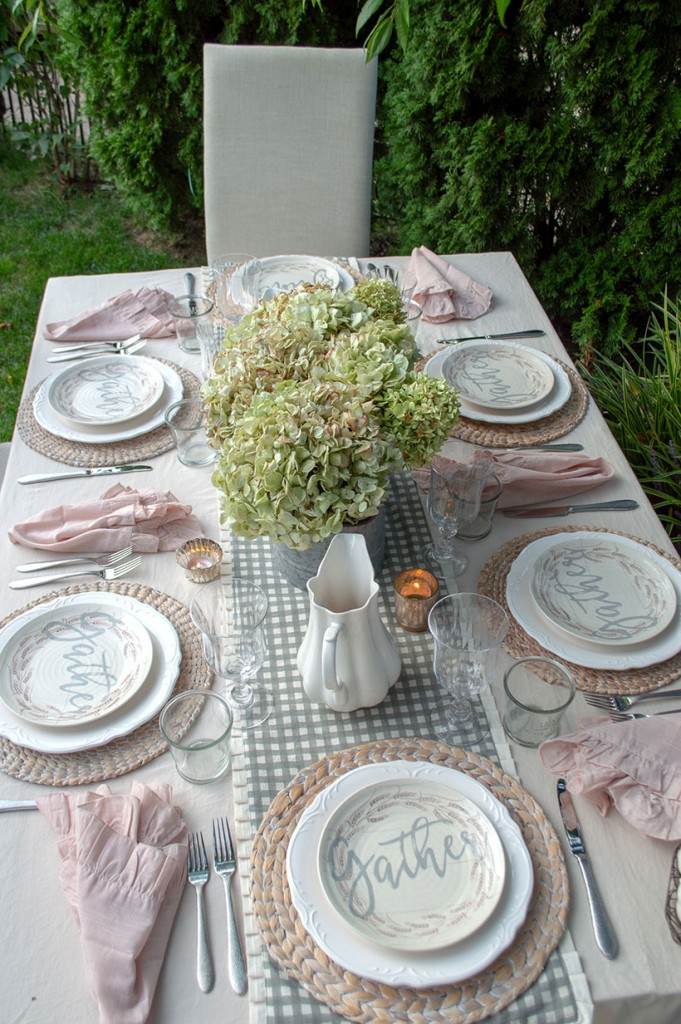 Gray and white gingham tablerunner on a romantic fall farmhouse tablescape.