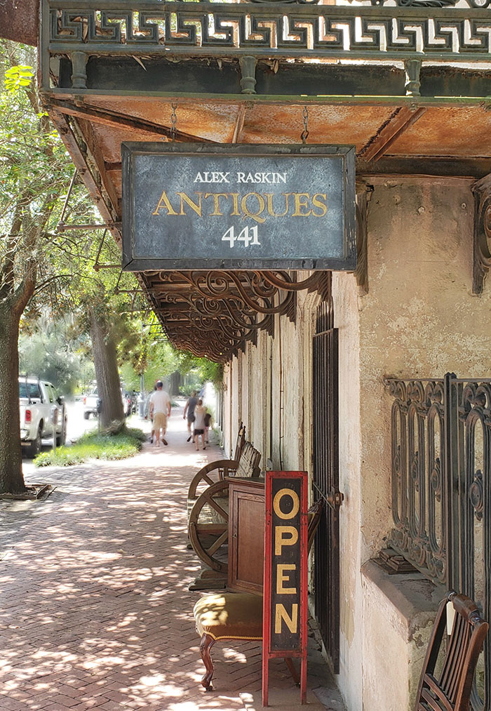 Store sign for Alex Raskin Antiques