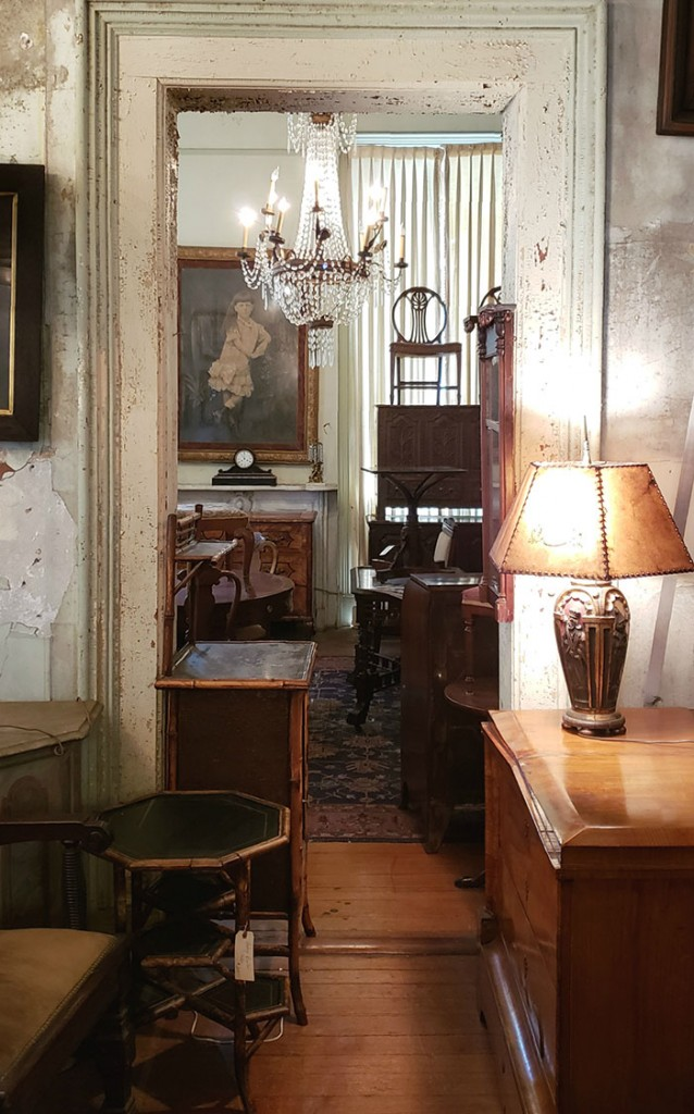 A hallway filled with antiques at the Nobel Hardee Mansion. The building now houses Alex Raskin Antiques