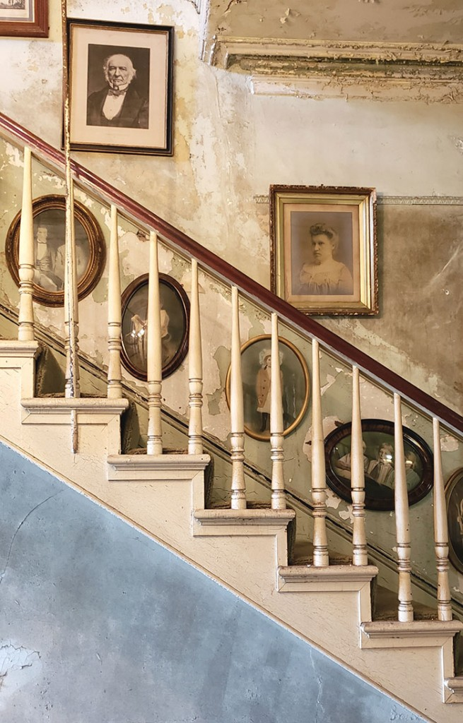 Antique portraits line the stairway of the Nobel Hardee Mansion in Savannah, Georgia. The building now houses Alex Raskin Antiques